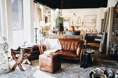 The current scene in our store. Antique leather, vintage finds, custom design. Monday's at Georgia Brown Home, Houston.