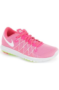 So pretty in pink! A tough, super-flexible rubber sole offers excellent cushioning in this comfortable running shoe from Nike that's designed to deliver an impeccably smooth ride.