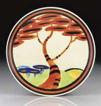 CLARICE CLIFF 'APPLIQUÉ RED TREE', A POTTERY PLATE, DESIGNED 1930-31