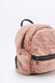 a7538069b084 Shop Faux-Fur Mini Backpack at Urban Outfitters today.