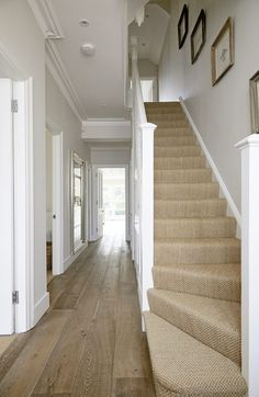 A contemporary farmhouse style location house in Wandsworth. White and neutral throughout with a good sized rear garden. Carpet Staircase, House Staircase, Staircase Design, Stairs With Carpet, Entrance Hall Decor, House Entrance, Narrow Hallway Decorating, Edwardian House, 1930s House