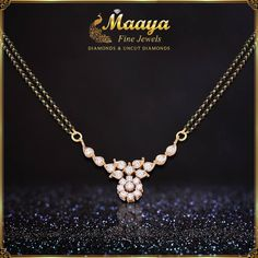 If you prefer delicate Mangalsutra pendants with diamonds, this one will look perfect on you. Diamond Mangalsutra, Gold Mangalsutra Designs, Gold Earrings Designs, Gold Jewellery Design, Bead Jewellery, Beaded Jewelry, Gold Jewelry, Diamond Jewellery, Gold Necklace
