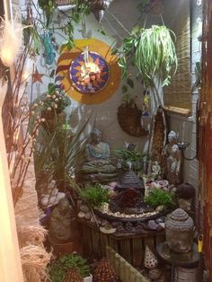 Delightful little fountain corner brimming with plants and statues.  Love it!
