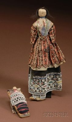 Northeast Beaded Cloth Corn Husk Doll and Cradle - View auction on www.skinnerinc.com