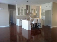 color scheme- white shaker cabinets, cream/grey ctop, dark bamboo/cherry floors, grey walls - ikea adel white cabinets