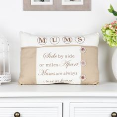 Finished with a warm sandy linen material alongside a cream polyester material featuring a beautiful saying reading' Mums, Side by side or miles apart mums are always close to the heart' printed in a chocolate brown print creating a memorable gift for that special lady in your life complimented by three cotton flower decorations with a button to the centre. A neutral cushion that can be used in almost any room in the house such as the bedroom, lounge or conservatory as it will compliment.