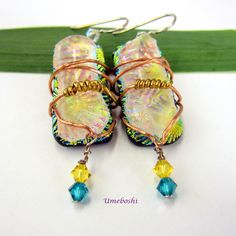 These unusual, one-of-a-kind, dichroic glass dangle earrings are wire wrapped in…