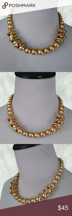 """VINTAGE Big and Bold Frosted Gold Bead Choker This fantastic statement choker is in like new condition. High end and well made it is co or used of graduated frosted gold tone metal balls ranging from 3/8"""" to 5/8"""" in diameter. There are two stations with three sets of 2 interlocking whiney gold tone rings measuring almost 1"""" in diameter encircling the beads. 18"""" in length. This is a classy statement necklace. Vintage Jewelry Necklaces"""