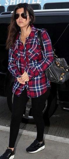 Who made  Kourtney Kardashian's black handbag and red plaid button down shirt?