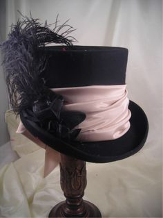 New Mad Hatter Black Felt Top Hat with Nude Sash. Inspired from Alice in Wonderland, we have designed a collection of whimsical Mad Hatter hats. Steampunk Hat, Steampunk Fashion, Steampunk Clothing, Steampunk Wedding, Gothic Fashion, Victorian Hats, Victorian Dresses, Mad Hatter Hats, Mad Hatters