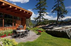 Simple pergola and outdoor dining space of the chalet