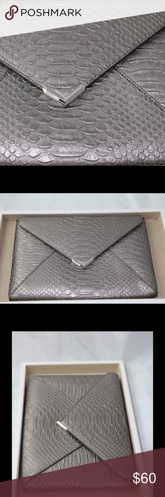 Stella & Dot slim pewter clutch Vegan leather. Inside is animal pattern. Holds up to 6 credit cards. Fits iPhone or iPad mini. Hidden magnetic clasp. Stella & Dot Bags Clutches & Wristlets