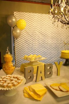 gray and yellow gender reveal party dessert table