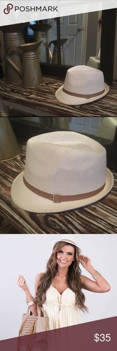 NWOT Fedora Hat New and unworn Fedora. White with tan detail. Just cleaning out the closet of items that aren't being worn. Tags for exposure: shop hopes, modern vintage boutique, red dress boutique, miss me, the mint julep, Dottie couture boutique, Nordstrom, Macy's, Zara, forever21, j Crew, loft, spool 72 Accessories Hats