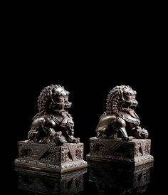 A PAIR OF BRONZE BUDDHIST LIONS ON RECTANGULAR STANDS, China, Qing dynasty
