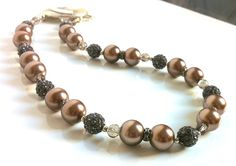 Chocolate Pearl Necklace Chocolate Brown by ClearWaterDesignsbyK clearwaterdesignsbyk.etsy.com clearwaterdesigns.info Elegant Chocolate Pearl & Smokey Grey Crystal Pave Bead Evening Necklace Set. Statement Toggle Clasp can be worn to the side. Perfect for the Bride Mother. Elegant for a night out. MEASUREMENTS: 18 inches