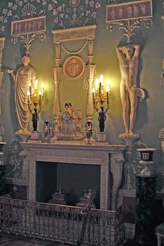 Catherine Palace (1752) - In the middle of the green dining room a marble fireplace with clips attached in the form of lions' heads and paws.
