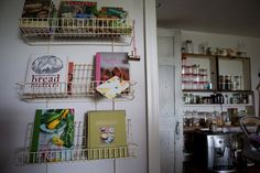 love the idea of displaying cookbooks in the kitchen