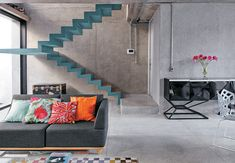 loft living space | concrete wall & floor