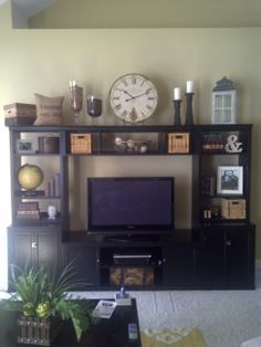 ideas for decorating the top of an entertainment center - Google Search