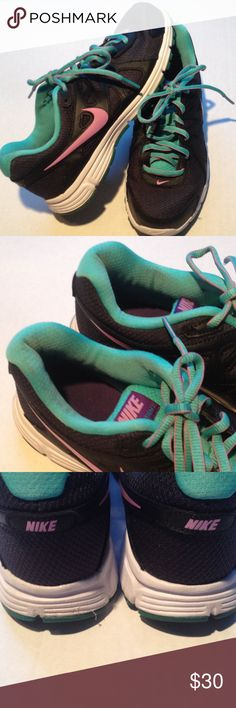 Nike Sneakers Nike Revolution 2 . In great condition. Some discoloration on turquoise cloth were feet go into the shoe. See it in photo. 2Very light so had to photograph. Nike Shoes Sneakers