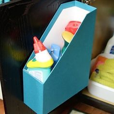 1. Apply adhesive stickers to all three corners of the file holder and stick it to the inside door of the cabinet under the sink. | 10 Creative Ways To Organize With Magazine Holders Around Your House