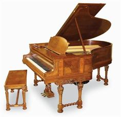 Steinway (c1919)  A 6ft 6in electric Duo-Art player grand piano in a walnut quarter-veneered and boxwood strung art case raised on dual-turned foliate decorated legs; together with a matching duet stool and a number of rolls.