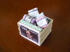 Miniature dollhouse crate of craft items of course there'll be a sewing room in my doll house!!