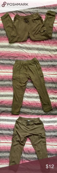 Army green cargo joggers Cargo pant joggers, with drawstring waist. Lightweight polyester material. Ankle length. These pants look adorable when worn casual with sneakers or chic when dressed up with heels. Charlotte Russe Pants