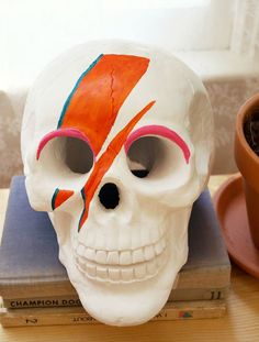 Give a typical skull some style with a little face paint. Customize the colors to match your celebration.  Source: A Beautiful Mess