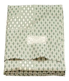 ¡Echa un vistazo! CONSCIOUS. Mantel en algodón orgánico con motivo estampado. – Visita hm.com para ver más.