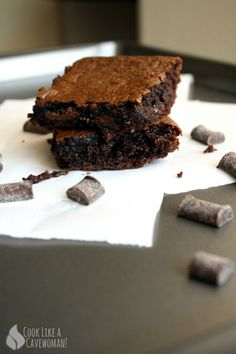 Paleo Double-Chocolate Flourless Brownies 1 tsp coconut oil, for greasing ½ cup creamy almond butter ¼ cup honey 2 eggs 2 tbsp ghee 1 tsp vanilla extract ⅓ cup cocoa powder ½ tsp baking soda 1 handful of chocolate chips (such as Enjoy Life's Mega Chunks)
