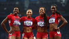 Francena McCorory, Allyson Felix, Sanya Richards-Ross and DeeDee Trotter of the United States celebrate winning gold in the Women's 4 x 400m Relay Final on Day 15 of the London 2012 Olympic Games at Olympic Stadium