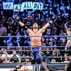 The Phenomenal One AJ Styles Love the AJ All Day sign in the back