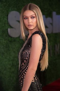 Long And Sleek - She really ditched the waves when she opted for ultra-long, straight extensions.
