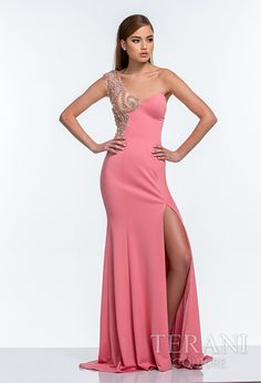 One shouldered jersey gown with swirling pearl embellishments running from the strap, over the waist, and onto the hip. the dress is finished with an a-line skirt and thigh high slit