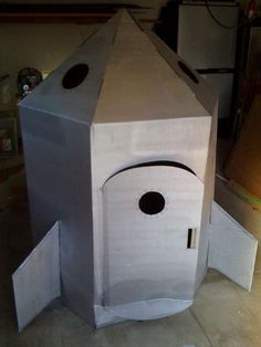 """How to build a cardboard Rocket ship  """"To make this you will need;  - A large refrigerator box.  - Misc. tools(box cutter, tape measure, straight edge, pencil, jigsaw)  - Three cans of gray spray paint  - A little imagination"""" Good tutorial."""