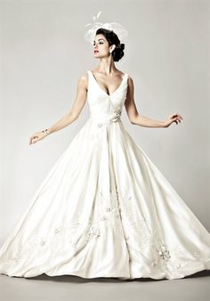 I love so much about this dress. The v-neck is elegant and the ballgown is not overdone!