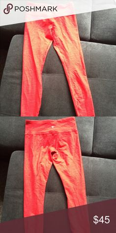 Red lulu lemon pants The picture makes them look orange but they are red! Super long and fit like XS. No sign of wear or tear. lululemon athletica Pants Leggings