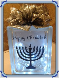 SPECIAL ORDER LASER ETCHED MENORAH W/HAPPY CHANUKAH IN NAVY BLUE WITH SILVER GLITTER RIBBON EMBELLISHMENT AND COOL LED BATTERY OPERATED LIGHTS. LASER ETCHING BY LAVENE & CO.