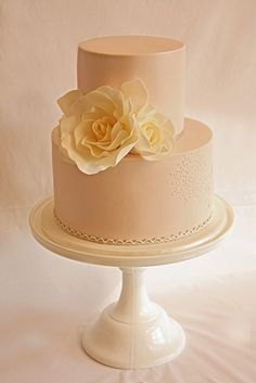 Gorgeous lace detailing on this wedding cake. So classic and yet contemporary. Petite rose and lace wedding cake