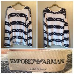 "Emporio Armani Geometric Sweater Great geometric sweater by Emporio Armani! Very warm. A few minor snags, probably fixable, see pics. Wide, bell-like sleeves. Included pics of armpits to show that there is not much wear, a lot of life left in this statement sweater!  Size USA 34 40'' chest, 29"" length, 30"" Sleeve 50% cotton / 50% Viscose Hand wash, dry flat Emporio Armani Sweaters Crew & Scoop Necks"