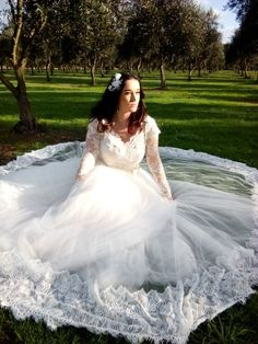 Lace and tulle gown with long sleeves