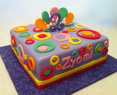 """November 2012. Purple birthday cake with circle design: white cake with strawberry cream cheese buttercream filling with buttercream icing, fondant and gumpaste """"2"""". Silver Cake Studio, Houston."""