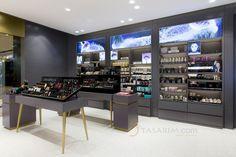 kozmetik mağazası cam raf sistemleri