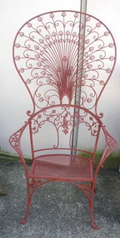 A Peacock wrought iron chair made by Florentine Craftsman, this company was the major NY competitor to Salterini. Also in inventory is the Salterini Version of this chair. The chair is approx 5ft tall. The chair dates from the 1920's  / Joan Bogart