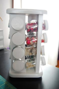Spice rack becomes button rack in your sewing room. Can also work for any other types of small objects / Rack à épices range les boutons dans la salle de couture