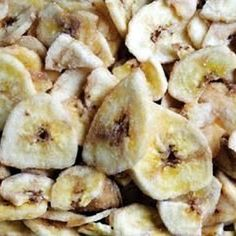 Dried Banana Chips, slice, spray pan with oil, place the slices, sprinkle fresh lemon juice, place the sheet in the oven 150F by an hour.