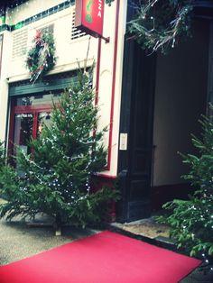 L'entrée festive du restaurant partenaire Chez Carlo