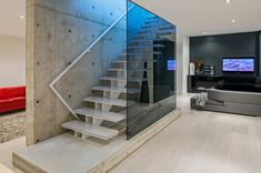 Basement stairs - There is no shortage of stairway design ideas to make your stairway a charming part of your home. Floating Staircase, Modern Staircase, Staircase Design, Basement Staircase, Basement Living Rooms, Modern Basement, Minimalist House Design, Modern House Design, Minimalist Style